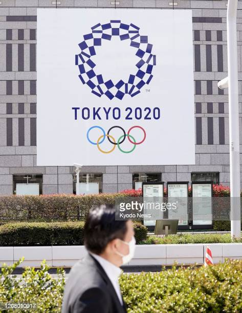 The Tokyo Olympics logo is shown on the wall of the Tokyo metropolitan government headquarters building on March 23, 2020. The International Olympic...