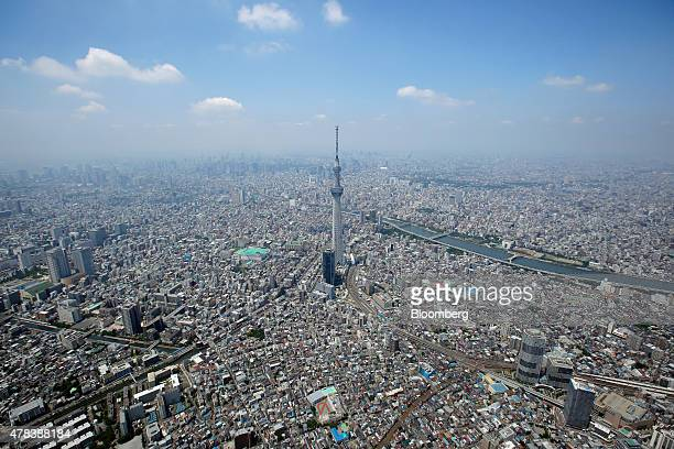 The Tokyo Skytree operated by Tobu Railway Co center stands in this aerial photograph taken in Tokyo Japan on Wednesday June 24 2015 The Abe...