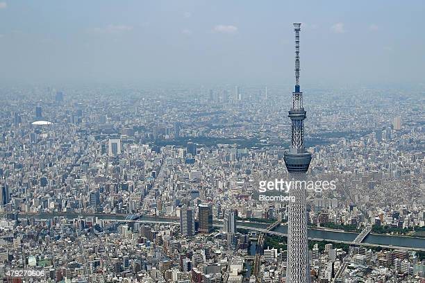 The Tokyo Skytree, operated by Tobu Railway Co., stands in this aerial photograph taken in Tokyo, Japan, on Wednesday, June 24, 2015. The Abe...