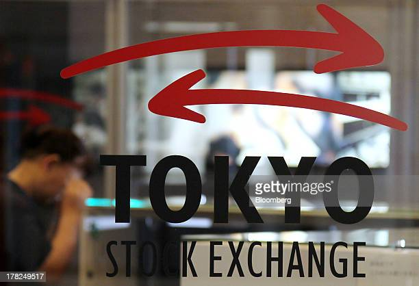 The Tokyo Stock Exchange logo is displayed at the bourse in Tokyo, Japan, on Wednesday, Aug. 28, 2013. Japanese shares declined, with the Topix index...
