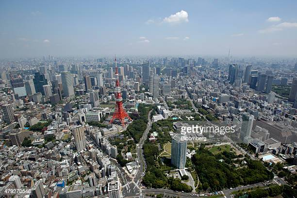 The Tokyo Tower, left, stands amid buildings in this aerial photograph taken in Tokyo, Japan, on Wednesday, June 24, 2015. The Abe administration...