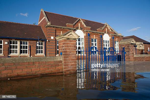 The Toll Bar Primary School is partly submerged by the floodwaters in Toll Bar village outside Doncaster This is one of the many institutions and...
