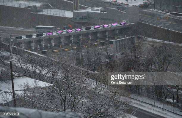 The tolls for the Lincoln tunnel sit empty as the winter storm Quinn hits on March 7 2018 in Union City New Jersey This is the second nor'easter to...