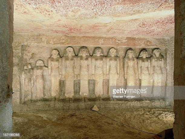 The tomb at Giza of Meresankh one of the queens of Khephren The large groups of statues cut into the rock represent the women of Queen Meres Ankhs...