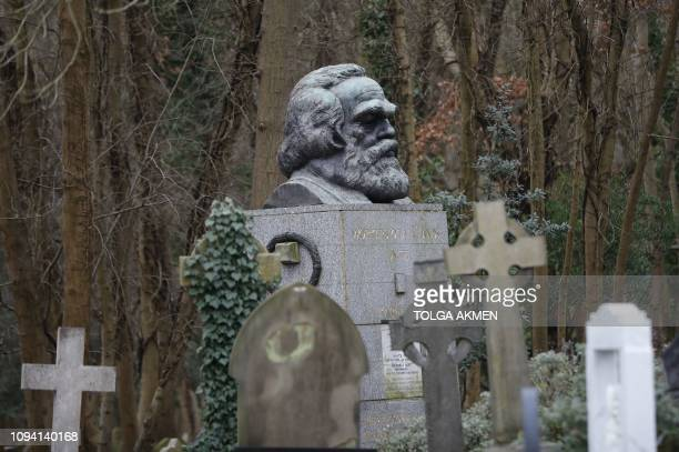 The tomb of German revolutionary philosopher Karl Marx a Grade Ilisted monument is seen in Highgate Cemetery in north London on February 5 2019...