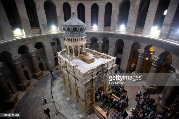 The tomb of Jesus Christ with the rotunda is seen in the Church of the Holy Sepulchre on March 21 2017 in Jerusalem Israel The tomb of Jesus Christ...