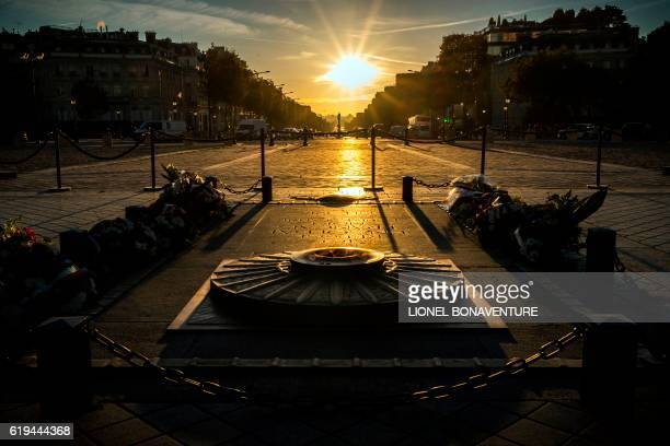 The tomb of the unknown soldier is pictured during the sunrise over the Champs Elysees in Paris on October 31 2016