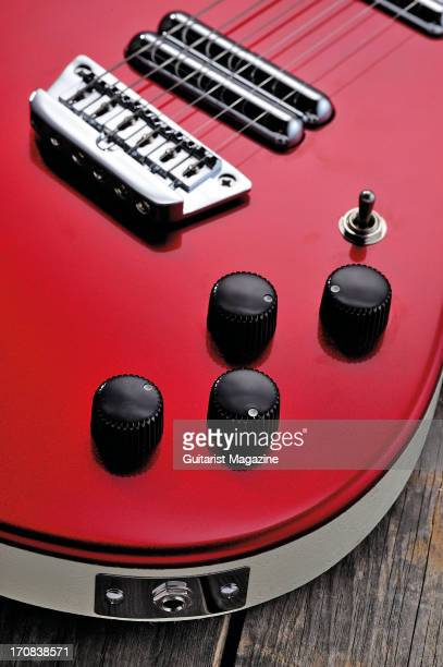 The tone control dials of a Danelectro Hodad electric guitar photographed during a studio shoot for Guitarist Magazine November 6 2012