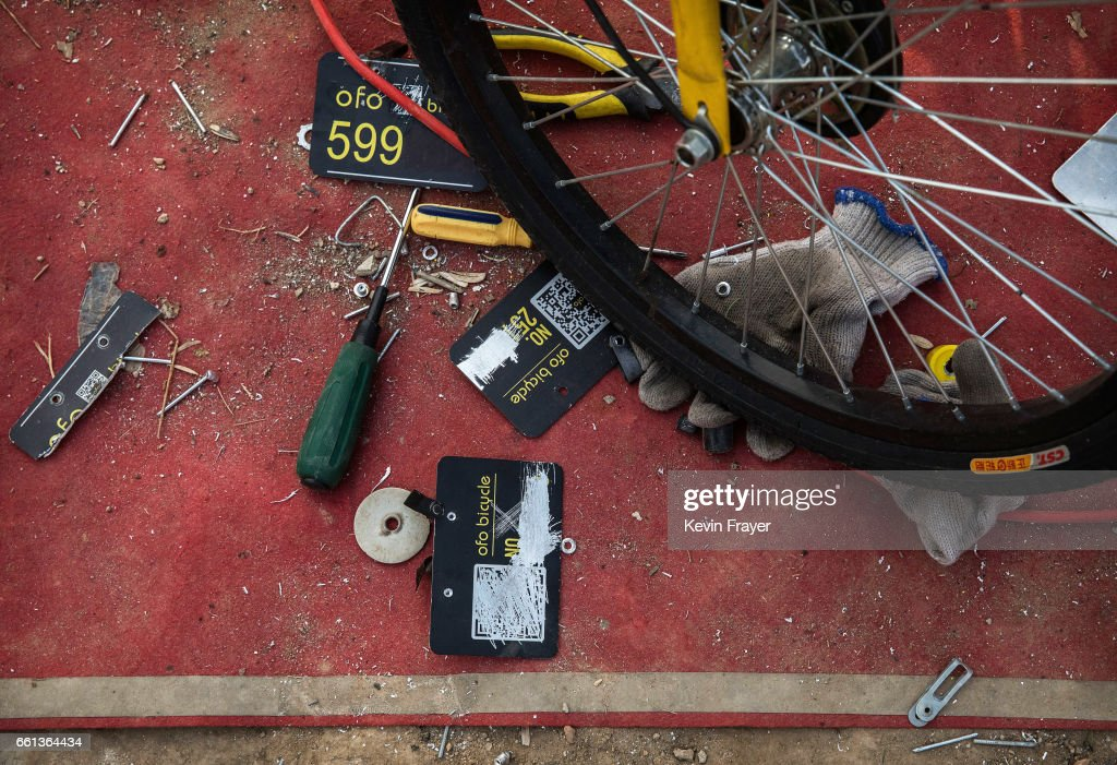 The tools of a Chinese worker from the bike share company Ofo Inc. are seen at a repair depot for the company on March 30, 2017 in Beijing, China. The popularity of bike shares has exploded in the past year with more than two dozen providers now battling for market share in major cities across China. The bikes are hailed as an efficient, cheap, and environmentally-friendly solution for commuters, where riders unlock the stationless bicycles using a mobile phone app, drop them anywhere for the next user, and spend as little as 1 yuan ($0.15) per hour. Given the bikes have several users a day - some of them inexperienced riders who swerve into traffic - they are often damaged, vandalized, or abandoned. Companies like Ofo routinely collect the battered two-wheelers and bring them to a makeshift depot that is part repair shop, part graveyard where they are either salvaged or scrapped. The bike shares are powering a cycling revival of sorts in a country once known as the 'Kingdom of Bicycles'. In the early years of Communist China, most Chinese aspired to own a bicycle as a marker of achievement. When the country's economic transformation made cars a more valued status symbol, the bicycle - a Chinese cultural icon - was mocked as a sign of backwardness. The bike share craze is also a boon for manufacturers who are now mass producing over a million bikes a month to meet demand, and the number of shared bike users will reach 50 million in China by the end of the year, according to Beijing-based BigData Research. Not everyone is cheering the revival though, as municipal officials are drafting new regulations to control the chaotic flood of bicycles on streets and sidewalks.