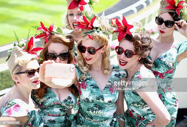 The Tootsie Rollers take a selfie on day 4 of Royal Ascot at Ascot Racecourse on June 19 2015 in Ascot England