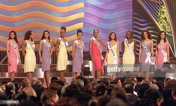 The top 10 delegates to the 1999 Miss Universe Pageant stand on stage as they are introduced 26 May at the Universe Centre in Chaguaramas Trinidad...