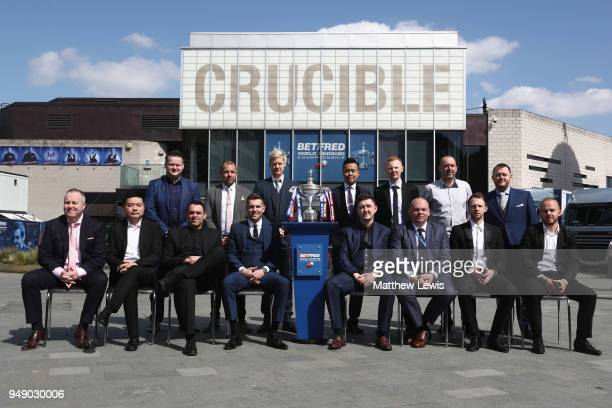 The top 15 players on the world ranking pose for a group photo during a media day ahead of the World Snooker Championships at Crucible Theatre on...