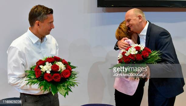 The top candidate in Saxony of the social democratic SPD party Martin Dulig looks on as the SPD's temporary co-leader Malu Dreyer congratulates...