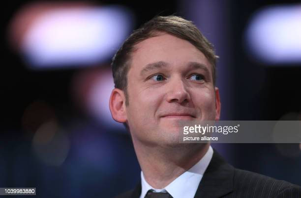 The top candidate of the party Alternative for Germany for the state parliament elections in the German state SaxonyAnhalt André Poggenburg looks on...