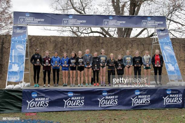 The top fifteen finishers accept their trophies during the Division II Women's Cross Country Championship held at the Angel Mounds on November 18...