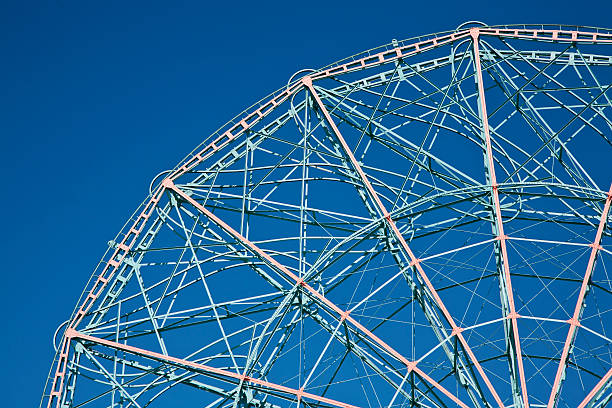 The top of a Ferris Wheel, low angle view