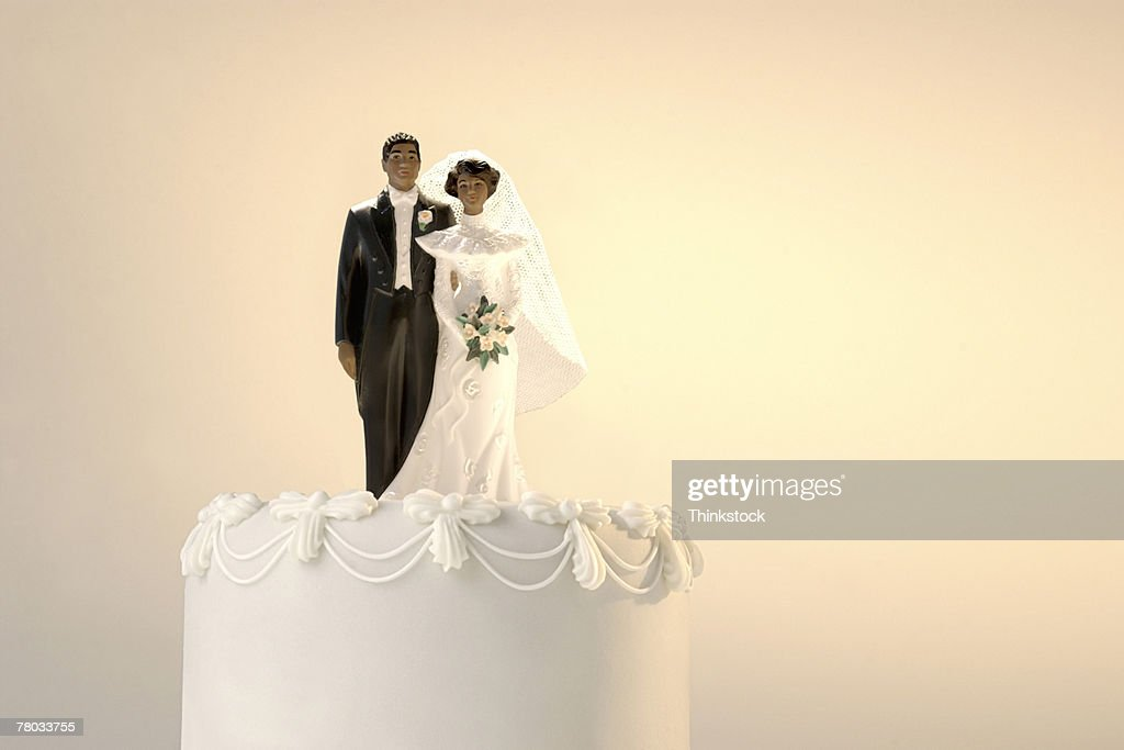 The Top Of A Wedding Cake With A Africanamerican Bride And Groom ...