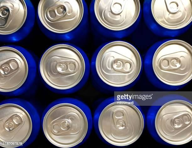 the top of an aluminum drink cans - high section stock pictures, royalty-free photos & images