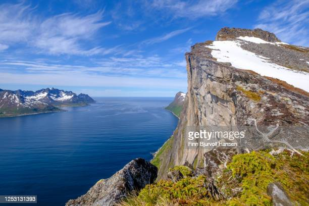 the top of mountain at trailhead hesten in fjordgard at the island senja in norway - finn bjurvoll stock pictures, royalty-free photos & images