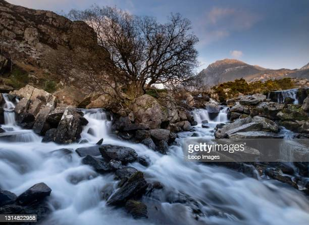 The top of Ogwen Falls and peak of Tryfan in the Ogwen Valley in Snowdonia.