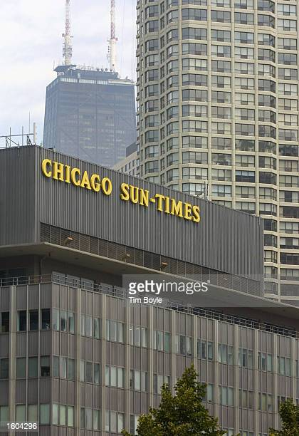 The top of the Chicago SunTimes building is seen July 25 2001 amongst a highrise and John Hancock buildings in downtown Chicago Donald Trump and the...