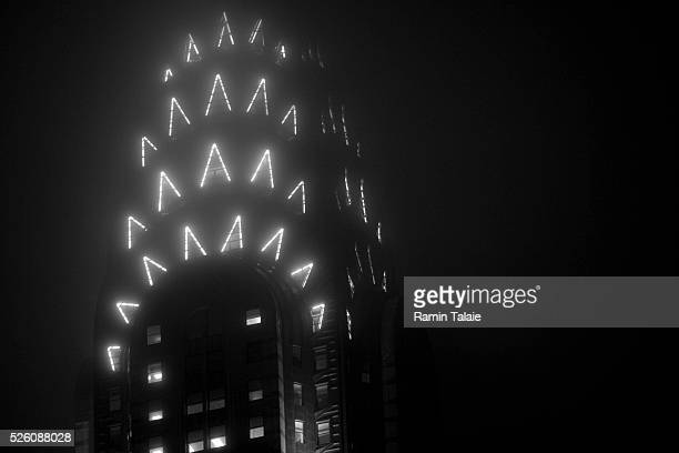 The top of the Chrysler building during a foggy night in New York City