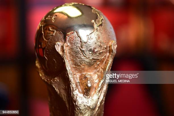 The top of the first replica of the FIFA football World Cup Trophy is pictured at the Italian trophy and medal manufacturer GDE Bertoni is pictured...