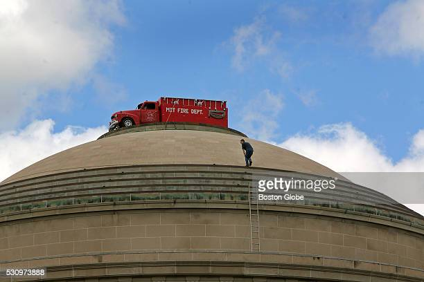 The top of the Massachusetts Institute of Technology dome in Cambridge Mass was decorated by what appeared to be a red MIT fire truck September 11...