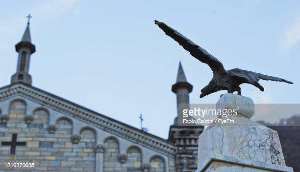 the top of the war memorial in argegno, como, lombardy, italy. - war memorial stock pictures, royalty-free photos & images