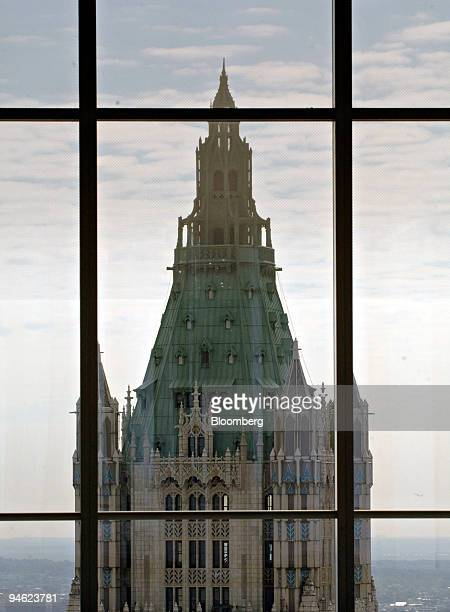 The top of the Woolworth Building is seen through the windows of the 52nd floor of 7 World Trade Center in New York Thursday August 17 2006