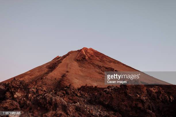 the top of volcano teide at sunrise, tenerife - volcanic terrain stock photos and pictures