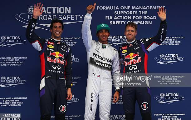 The top qualifiers Daniel Ricciardo of Australia and Infiniti Red Bull Racing Lewis Hamilton of Great Britain and Mercedes GP and Sebastian Vettel of...