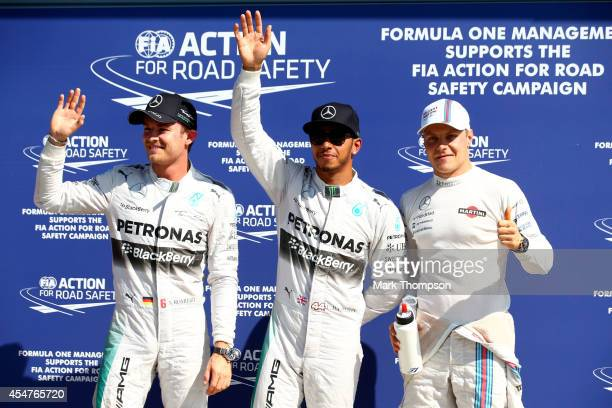 The top three qualifying drivers Nico Rosberg of Germany and Mercedes GP Lewis Hamilton of Great Britain and Mercedes GP and Valtteri Bottas of...