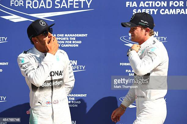 The top two qualifying driversLewis Hamilton of Great Britain and Mercedes GP and Nico Rosberg of Germany and Mercedes GP pose for the cameras...