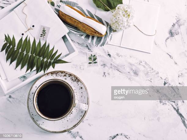 the top view of marble desk with cup of coffee and  book - decoración objeto fotografías e imágenes de stock