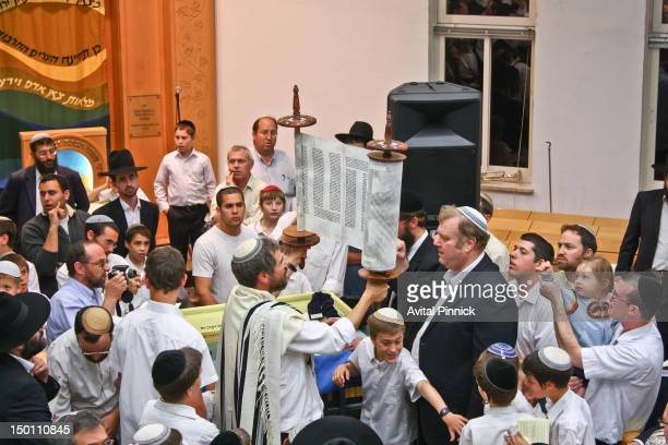 The Torah scroll is held up so that the congregation can see the writing. Torah scroll dedication ceremony in Israel.