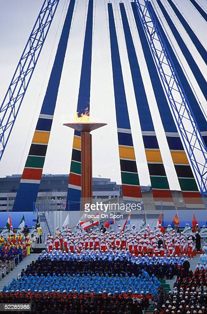 The torch is lit during the opening ceremonies of the Winter Olympics at MacMahon Stadium on Febuary 13 1988 in Calgary Canada
