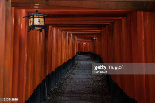 The torii path at Fushimi Inari-taisha shrine, one of Japan's most popular tourist destinations, is pictured empty on April 22, 2020 in Kyoto, Japan....