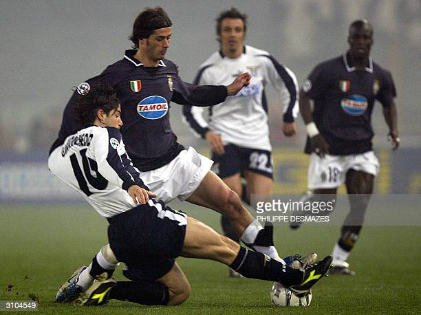 The Torino forward Alessio Tacchinardi is challenged by the Roma defender Giuliano Giannichedda during the 1th round of the final cup 17 March 2004...