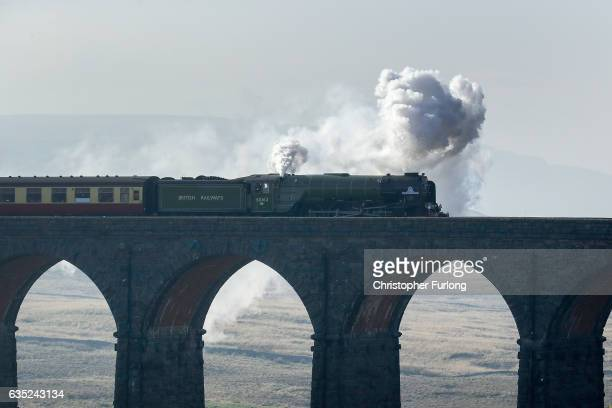 The Tornado steam locomotive pulls the first timetabled main line steamhauled service for half a century across the Ribblehead viaduct in North...