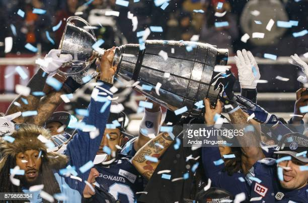 The Toronto Argonauts raise the Grey Cup over their heads as they celebrate winning the 105th Grey Cup Championship Game against the Calgary...