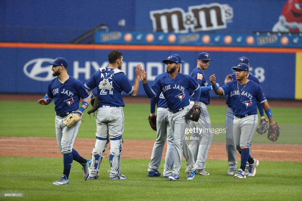 The Toronto Blue Jays celebrate a 12-1 win against the New York Mets after their game at Citi Field on May 16, 2018 in New York City.