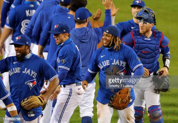 The Toronto Blue Jays celebrate a win against the New York Yankees at Sahlen Field and celebrate a 2020 postseason berth on September 24 2020 in...