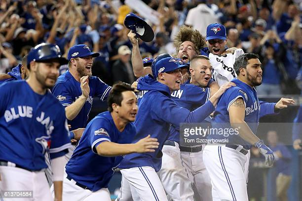 The Toronto Blue Jays celebrate after defeating the Texas Rangers 76 in ten innings during game three of the American League Division Series at...