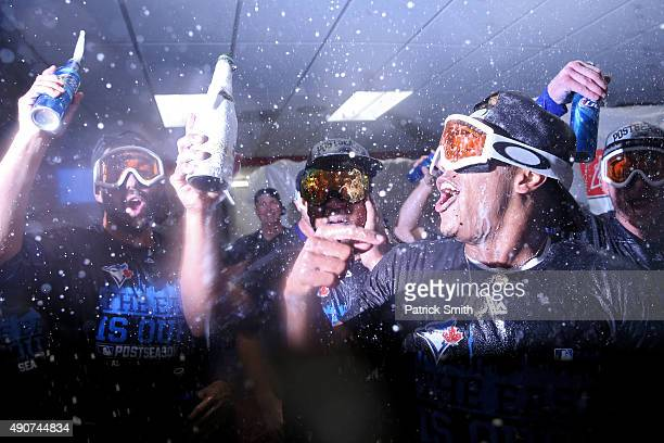 The Toronto Blue Jays celebrate in the clubhouse after defeating the Baltimore Orioles and clinching the AL East Division following game two of a...