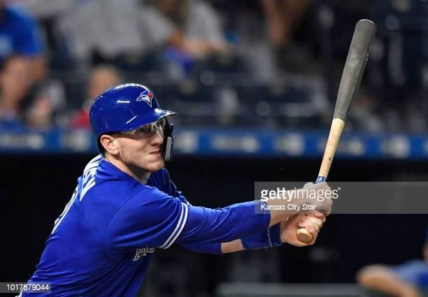 The Toronto Blue Jays' Danny Jansen follows through on a sacrifice fly to score Teoscar Hernandez in the second inning against the Kansas City Royals...
