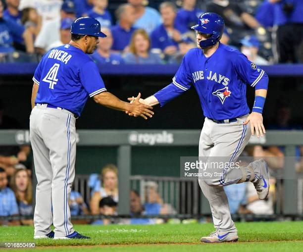 The Toronto Blue Jays' Danny Jansen right is greeted by third base coach Luis Rivera after Jansen hit a solo home run in the fourth inning against...