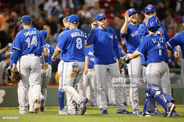 The Toronto Blue Jays high five each other after a victory over the Boston Red Sox at Fenway Park on September 4 2017 in Boston Massachusetts