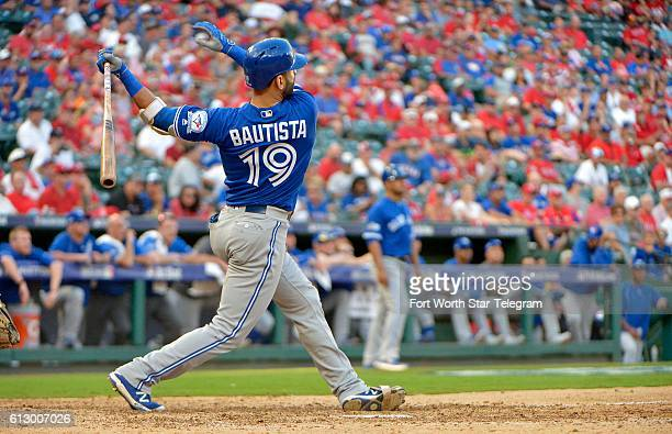 The Toronto Blue Jays' Jose Bautista hits a threerun home run during the ninth inning against the Texas Rangers in Game 1 of the ALDS at Globe Life...