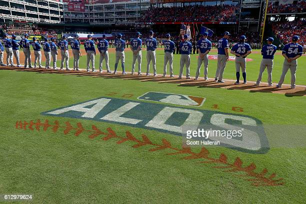 The Toronto Blue Jays line up during the national anthem prior to game one of the American League Divison Series against the Texas Rangers at Globe...